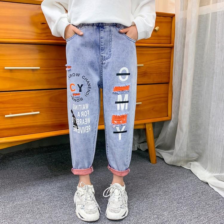 女童桔红底破洞裤